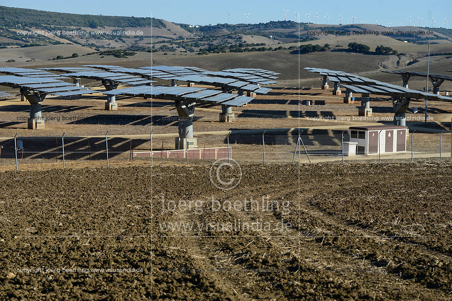 Spain, Andalusia, Cadiz, Vejer de la Frontera, solar power station with flat heliostats, behind wind farm on the mountains