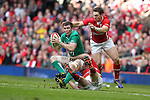 Ireland flanker Peter O'Mahony looks for support as Wales prop Gethin Jenkins makes the tackle..RBS 6 Nations.Wales v Ireland.Millennium Stadium.02.02.13.©Steve Pope-SPORTINGWALES
