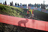 Marcel Meisen (DEU/Corendon-Kwadro) recons the course (accompanied by his shadow)<br /> <br /> Jaarmarktcross Niel 2014