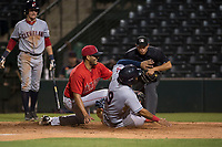 AZL Angels relief pitcher Cristia Reyes (33) applies the tag to Felix Fernandez (9) in front of home plate umpire Shin Koishizawa during an Arizona League game against the AZL Indians 2 at Tempe Diablo Stadium on June 30, 2018 in Tempe, Arizona. The AZL Indians 2 defeated the AZL Angels by a score of 13-8. (Zachary Lucy/Four Seam Images)