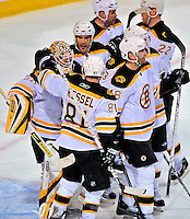 22 April 2009: Boston Bruins' goaltender Tim Thomas is congratulated by teammates after defeating the Montreal Canadiens at the Bell Centre in Montreal, Quebec, Canada. The Bruins advance to the Eastern Semi-Finals, eliminating the Canadiens from Stanley Cup competition with their 4-1 win and series sweep. ***** Editorial Sales Only ***** Mandatory Credit: Ed Wolfstein Photo