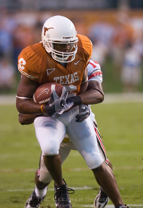 09 September 2006: Texas receiver Quan Cosby is tackled by an Ohio State defender during the Texas Longhorns 24-7 loss to the Buckeyes at Darrell K Royal Memorial Stadium in Austin, TX.