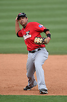 Frisco Rough Riders shortstop Guilder Rodriguez (6) throws to first during the first game of a doubleheader against the Tulsa Drillers on May 29, 2014 at ONEOK Field in Tulsa, Oklahoma.  Frisco defeated Tulsa 13-4.  (Mike Janes/Four Seam Images)
