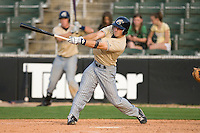 Adam White #7 of the Lake County Captains follows through on his swing versus the Kannapolis Intimidators at Fieldcrest Cannon Stadium May 3, 2009 in Kannapolis, North Carolina. (Photo by Brian Westerholt / Four Seam Images)