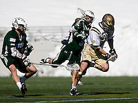 Cooper MacDonnell (16) of Loyola makes the ball drop out of the pocket of the stick of Jay Mann (47) of Navy at the Navy-Marine Corp Memorial Stadium in Annapolis, Maryland.   Loyola defeated Navy, 8-7, in overtime.