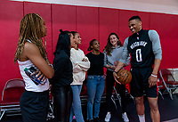 HOUSTON, TX - FEBRUARY 1: Russell Westbrook of the Houston Rockets talks with members of the USWNT at Houston Rockets Training Center on February 1, 2020 in Houston, Texas.