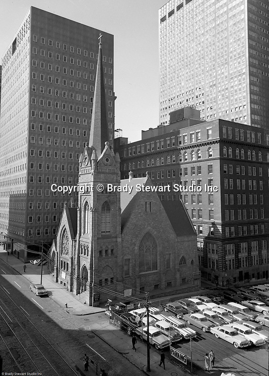 Pittsburgh PA: View of the First English Evangelical Church in downtown Pittsburgh.  Founded in 1837, the church was the first English-speaking Lutheran Church west of the Allegheny Mountains. This building on Grant Street was dedicated in 1888.  The Alcoa and  H.K. Porter buildings are in the background.