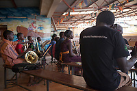 Ghetto Classics is a community programme of the Art of Music Foundation in Nairobi, Kenya. It involves over 300 children in Korogocho – one of Kenya's biggest slums that is home to about 300.000 people. Music education is used to provide the youth with opportunities to better themselves and their community. The programme teaches them life skills that come with the discipline of studying art music, and provides them with income generating opportunities. The Art of Music Foundation was founded in 2009 with a mission to promote the performance and appreciation of music in Kenya and use its transformative power to change lives, particularly of those living in underprivileged areas of the country.