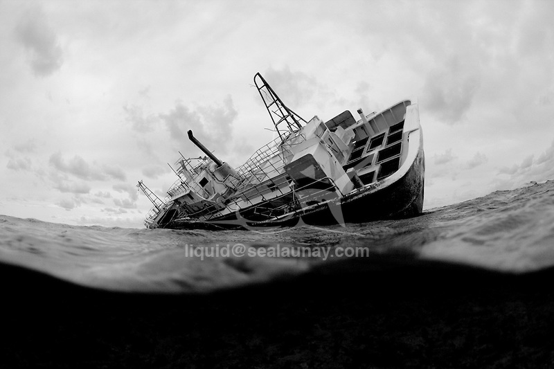 Shipwrecks aground on Middleton Reef, is a coral reef in the Tasman sea..Middleton Reef.Middleton Reef 29°27?28?S 159°7?7?E? / ?29.45778°S 159.11861°E? / -29.45778; 159.11861Coordinates: 29°27?28?S 159°7?7?E? / ?29.45778°S 159.11861°E? / -29.45778; 159.11861 is a coral reef in the Tasman Sea. It is separated by a deep oceanic pass some 45 km wide from nearby Elizabeth Reef, forming part of the Lord Howe Rise underwater plateau. Middleton Reef is around 220 km from Lord Howe Island and 555 km from the coast of New South Wales. In 1997 the Environment, Sport and Territories Legislation Amendment Bill 1996 included Middelton Reef in Australia's Coral Sea Islands Territory.This island is included also in Elizabeth and Middleton Reefs.Middleton Reef is a platform reef and is among the southernmost platform reefs in the world. However, despite its relatively high latitude, a wide variety of flora and fauna exists both on the island and in the surrounding waters. This is due to its location where tropical and temperate ocean currents converge..Middleton reef is about 8.9 km long by 6.3 km wide and is usually submerged. However, at low tide most of the reef flat is exposed. At high tide only one cay on the reef is visible, at one metre above sea level. The cay is called The Sound and is 100 m by 70 m..The reefs form the Elizabeth and Middleton Reefs Marine National Park Reserve managed by the Government of Australia under the Natural Heritage Trust..Middleton Reef image from NASA Millennium Coral Reef Mapping Project.Surveys by the Australian Institute of Marine Science have highlighted healthy number of Black Cod Epinephelus daemelii which is now a threatened species[1] in NSW waters.[2] The survey in 2003 highlighted some 111 species of coral and at the same time identified 181 species of fish. The total number of recorded fish species on the reef is 311 across several surveys. High numbers of Galapagos sharks Carcharhinus galapagensis were observed at Elizabeth Reef and