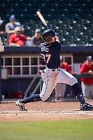 Northwest Arkansas Naturals infielder Travis Jones (27) connects on a pitch on May 19, 2019, at Arvest Ballpark in Springdale, Arkansas. (Jason Ivester/Four Seam Images)