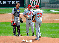 4 July 2009: Atlanta Braves' catcher David Ross watches as Manager Bobby Cox hands the ball to relief pitcher Peter Moylan during a game against the Washington Nationals at Nationals Park in Washington, DC. The Nationals defeated the Braves 5-3 to take the second game of the 3-game weekend series. Mandatory Credit: Ed Wolfstein Photo