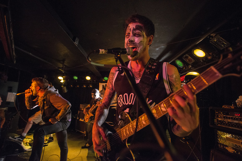 Guitarist Matt Dumlao and vocalist Corey Hagedon do their best juggalo impressions as City in Ashes performs during a pre-halloween show at Chilkoot Charlie's.