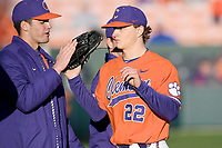 Starting pitcher Sam Weatherly (22) of the Clemson Tigers is greeted after completing a scoreless inning. Weatherly recorded 14 strikeouts in 6 innings to earn the 2-0 win in a game against the Stony Brook Seawolves on Friday, February 21, 2020, at Doug Kingsmore Stadium in Clemson, South Carolina. (Tom Priddy/Four Seam Images)