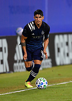 LAKE BUENA VISTA, FL - JULY 26: Alan Pulido of Sporting KC runs with the ball during a game between Vancouver Whitecaps and Sporting Kansas City at ESPN Wide World of Sports on July 26, 2020 in Lake Buena Vista, Florida.