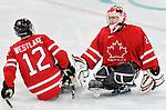 Benoit St-Amand and Greg Westlake, Vancouver 2010 - Para Ice Hockey // Para-hockey sure glace.<br /> Team Canada plays against Sweden in Para Ice Hockey action // Équipe Canada joue contre la Suède dans un match de para-hockey sur glace. 14/03/2010.