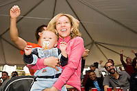 Czech Republic fan Martina Kulisek dances in celebration with her baby Viktor for a Czech Republic victory against the United States at the Bohemian Hall and Beer Garden in New York City on June 12, 2006.<br /> <br /> The World Cup, held every four years in different locales, is the world's pre-eminent sports tournament in the world's most popular sport, soccer (or football, as most of the world calls it).  Qualification for the World Cup is open to any country with a national team accredited by FIFA, world soccer's governing body. The first World Cup, organized by FIFA in response to the popularity of the first Olympic Games' soccer tournaments, was held in 1930 in Uruguay and was participated in by 13 nations.    <br /> <br /> As of 2010 there are 208 such teams.  The final field of the World Cup is narrowed down to 32 national teams in the three years preceding the tournament, with each region of the world allotted a specific number of spots.  <br /> <br /> The World Cup is the most widely regularly watched event in the world, with soccer teams being a source of national pride.  In most nations, the whole country is at a standstill when their team is playing in the tournament, everyone's eyes glued to their televisions or their ears to the radio, to see if their team will prevail.  While the United States in general is a conspicuous exception to the grip of World Cup fever there is one city that is a rather large exception to that rule.  In New York City, the most diverse city in a nation of immigrants, the melting pot that is America is on full display as fans of all nations gather in all possible venues to watch their teams and celebrate where they have come from.