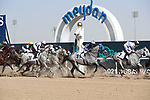 March 27, 2021: The field runs by for the first time in the Kahayla Classic on Dubai World Cup Day, Meydan Racecourse, Dubai, UAE. Shamela Hanley/Eclipse Sportswire/CSM