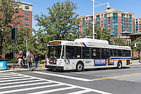 Westchester Bee-line system route 32 Yonkers loop bus waits for passengers outside of the train station in Yonkers, New York.