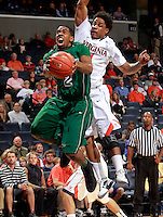 CHARLOTTESVILLE, VA- NOVEMBER 26:  Terry Johnson #2 of the Green Bay Phoenix shoots in front of Jontel Evans #1 of the Virginia Cavaliers during the game on November 26, 2011 at the John Paul Jones Arena in Charlottesville, Virginia. Virginia defeated Green Bay 68-42. (Photo by Andrew Shurtleff/Getty Images) *** Local Caption *** Terry Johnson;Jontel Evans