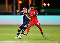 LAKE BUENA VISTA, FL - JULY 26: Anton Tinnerholm of New York City FC is challenged by Jayden Nelson of Toronto FC fir the ball during a game between New York City FC and Toronto FC at ESPN Wide World of Sports on July 26, 2020 in Lake Buena Vista, Florida.