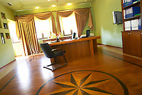 The office of the manager. with wood parquet floor with wood inlays in star shape. Kantina e Pijeve Gjergj Kastrioti Skenderbeu Skanderbeg winery, Durres. Albania, Balkan, Europe.