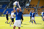 St Johnstone v Fleetwood Town…24.07.21  McDiarmid Park<br />Shaun Rooney hoists the Scottish Cup aloft to fans in the Esat Stand.<br />Picture by Graeme Hart.<br />Copyright Perthshire Picture Agency<br />Tel: 01738 623350  Mobile: 07990 594431