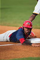 Edmundo Sosa (19) of the Johnson City Cardinals steals third base against the Bristol Pirates at Boyce Cox Field on July 7, 2015 in Bristol, Virginia.  The Cardinals defeated the Pirates 4-1 in game one of a double-header. (Brian Westerholt/Four Seam Images)