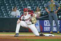 Arkansas Razorbacks first baseman Heston Kjerstad (18) tries to pick a low throw during the game against the Baylor Bears in game nine of the 2020 Shriners Hospitals for Children College Classic at Minute Maid Park on March 1, 2020 in Houston, Texas. The Bears defeated the Razorbacks 3-2. (Brian Westerholt/Four Seam Images)