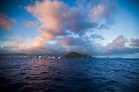 Pink clouds over Diamond Head at sunset, with Waikiki hotels on the left and Black Point and Koko Head on the right, O'ahu.