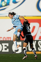 Keeley Dowling (17) of Sky Blue FC and Han Duan (9) of the Los Angeles Sol. The Los Angeles Sol defeated Sky Blue FC 2-0 during a Women's Professional Soccer match at TD Bank Ballpark in Bridgewater, NJ, on April 5, 2009. Photo by Howard C. Smith/isiphotos.com