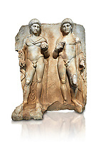Roman Sebasteion relief  sculpture of  Two princes, Aphrodisias Museum, Aphrodisias, Turkey.  Against a white background.<br /> <br /> Two princes stand like statues, naked, wearing cloaks. The left figure holds the orb of the world in one hand, a symbol of  world rule that indicates he is the imperial heir, and in the other a ship's stern ornament (aphlaston), a symbol of naval victory. They and probably Gius and Lucius, the grandsons of Augustus, or Nero and Britanicus, Claudius' heir.