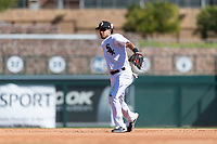 Glendale Desert Dogs second baseman Laz Rivera (8), of the Los Angeles Dodgers organization, throws to first base during an Arizona Fall League game against the Mesa Solar Sox at Camelback Ranch on October 15, 2018 in Glendale, Arizona. Mesa defeated Glendale 8-0. (Zachary Lucy/Four Seam Images)