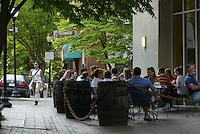 People eat at restuarant on the corner.
