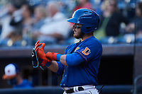 Esteban Quiroz (13) of the Durham Bulls adjusts his batting gloves as he waits for his turn to hit during the game against the Jacksonville Jumbo Shrimp at Durham Bulls Athletic Park on May 15, 2021 in Durham, North Carolina. (Brian Westerholt/Four Seam Images)