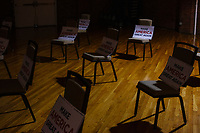 """Campaign signs reading """"Make America Great Again"""" rest on socially distanced chairs before the audience enters the venue before Eric Trump, son of US president Donald Trump, holds a Make America Great Again! campaign rally at the DoubleTree by Hilton Manchester Downtown in Manchester, New Hampshire, on Mon., Oct. 19, 2020. The chairs are distanced to follow safety protocols during the ongoing Coronavirus (COVID-19) global pandemic, just a few weeks after Donald Trump himself contracted the disease, though many other Trump campaign events are lax about COVID safety protocols."""