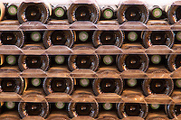 A pile of bottles stacked high with the bottle bottoms and bottle necks. Tax stamp. Domaine la Monardiere Monardière, Vacqueyras, Vaucluse, Provence, France, Europe