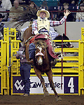1/24/09--Photo by Rick Davis--PRCA cowboy Ty Breuer of Mandan, North Dakota scores an 83 point bareback bronc ride on the Calgary Rodeo Company bronc Minus Forty during action at the 103rd National Western Stock Show and Rodeo in Denver, Colorado.