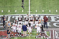 Referee Tom Ritter performs ceremonial coin toss before NCAA Football game kickoff between Texas A&M and Arkansas, Saturday, September 27, 2014 in Arlington, Tex. Texas A&M defeated Arkansas 35-28 in overtime. (Mo Khursheed/TFV Media via AP Images)