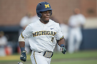 Michigan Wolverines second baseman Ako Thomas (4) runs to first base against the Michigan State Spartans during the NCAA baseball game on April 18, 2017 at Ray Fisher Stadium in Ann Arbor, Michigan. Michigan defeated Michigan State 12-4. (Andrew Woolley/Four Seam Images)