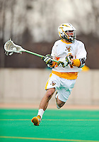 10 April 2011: University of Vermont Catamount attacker Connor McNamara, a Freshman from Winchester, MA, in action against the University at Albany Great Danes on Moulton Winder Field in Burlington, Vermont. The Catamounts defeated the visiting Danes 11-6 in America East play. Mandatory Credit: Ed Wolfstein Photo