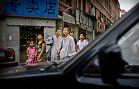 Chinese monks cross a street in Shenyang, China, Aug. 12, 2008 during the Olympics...Photo by Roberto Candia
