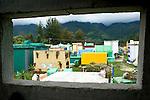 Window to a cemetery in Nabaj, Western Highlands, Guatemala