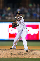 Charlotte Knights relief pitcher Jairo Asencio (38) closes out the game against the Norfolk Tides at BB&T BallPark on April 9, 2015 in Charlotte, North Carolina.  The Knights defeated the Tides 6-3.   (Brian Westerholt/Four Seam Images)