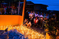 Afro-Colombian Catholic followers light candles while taking part in a religious procession during the San Pacho festival in Quibdó, Colombia, 4 October 2019. Every year at the turn of September and October, the capital of the Pacific region of Chocó holds the celebrations in honor of Saint Francis of Assisi (locally named as San Pacho), recognized as Intangible Cultural Heritage by UNESCO. Each day carnival groups, wearing bright colorful costumes and representing each neighborhood, dance throughout the city, supported by brass bands playing live music. The festival culminates in a traditional boat ride on the Atrato River, followed by massive religious processions, which accent the pillars of Afro-Colombian's identity – the Catholic devotion grown from African roots.