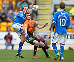 St Johnstone v Dundee United...19.04.14    SPFL<br /> Dave Mackay tackles Gavin Gunning<br /> Picture by Graeme Hart.<br /> Copyright Perthshire Picture Agency<br /> Tel: 01738 623350  Mobile: 07990 594431