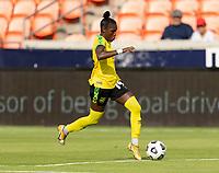 HOUSTON, TX - JUNE 10: Deneisha Blackwood #14 of Jamaica dribbles the ball during a game between Nigeria and Jamaica at BBVA Stadium on June 10, 2021 in Houston, Texas.
