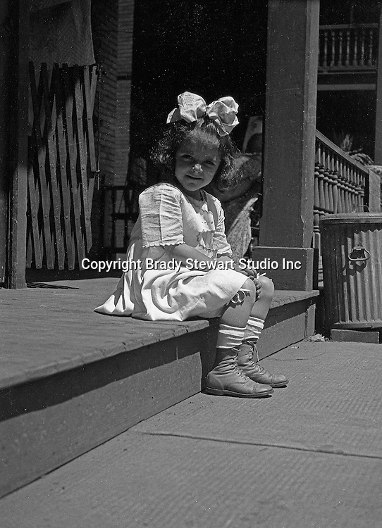 Wilkinsburg PA:  Helen Stewart sitting on the front porch waiting for dad (Brady Stewart) to come home from work.