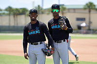 Miami Marlins Richard Roman (87) and Angeudis Santos (58) during a Minor League Spring Training camp day on April 28, 2021 at Roger Dean Chevrolet Stadium Complex in Jupiter, Fla.  (Mike Janes/Four Seam Images)