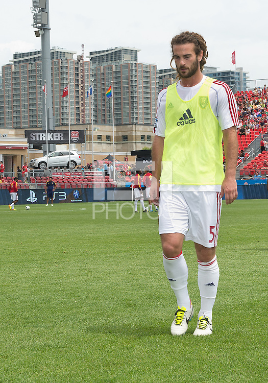 29 June 2013: Real Salt Lake midfielder Kyle Beckerman #5 walks off the pitch after warm-ups during an MLS game between Real Salt Lake and Toronto FC at BMO Field in Toronto, Ontario Canada.<br /> Real Salt Lake won 1-0.