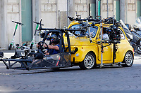 Actor Tom Cruise and actress Hayley Atwell in a yellow Fiat 500 driven by a stuntman on the set of the film Mission Impossible 7 shot in Via Nazionale.<br /> Rome (Italy), October 9th 2020<br /> Photo Samantha Zucchi Insidefoto